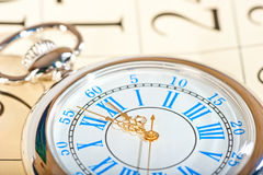 Silver watch with gold hands and calendar closeup Royalty Free Stock Photography