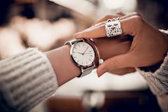 Silver watch on woman hand royalty free stock photo
