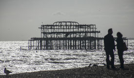 Silver waters and the old pier in Brighton. Royalty Free Stock Photos