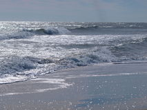Silver Waves. Sun glistening off the waves at New Smyrna Beach in Florida Royalty Free Stock Photography
