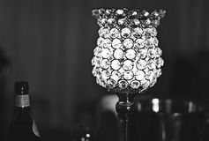The glass table lamps at Silver Wedding Party B&W. Silver Wedding Anniversary Party. The ambient table lamps of glass. Black & White/ Monochrome stock photo
