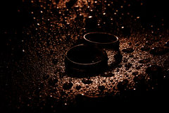Silver wedding rings between drops. Macro, water object Royalty Free Stock Photos