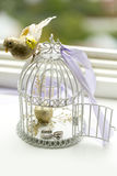 Silver wedding rings and engagement ring in decorative cage of bird Stock Image