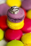 Silver wedding rings and engagement ring on macaroon Stock Photo