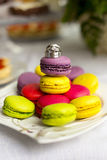 Silver wedding rings and engagement ring on macaroon Royalty Free Stock Photos
