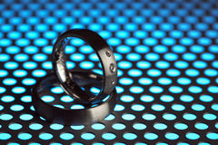 Silver wedding rings on industrial background Stock Photography