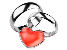 Silver wedding rings and red heart Stock Images