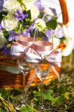 Silver wedding rings on ribbon or bow on glass with champagne Stock Photos