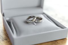 Silver wedding rings in white leather box royalty free stock photo