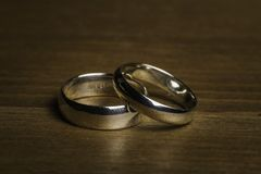 Silver Wedding Rings on a wooden background royalty free stock photo