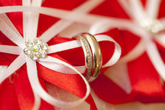 Silver wedding rings on red and white ribbons and rhinestones Royalty Free Stock Photography