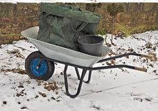 silver wheelbarrow in the snow royalty free stock images
