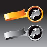 Silver whistle on orange and gray ribbons Stock Images