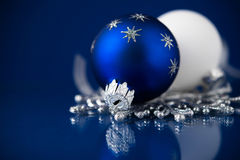 Silver, white and blue christmas ornaments on dark blue background. Merry christmas card. Happy holidays stock photos