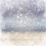 Silver and white bokeh defocused lights with snowflake overlay . abstract background Royalty Free Stock Photography