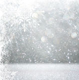 Silver and white bokeh defocused lights with snowflake overlay . abstract background. Stock Photos