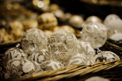 Silver white christmas balls in basket sold on market Royalty Free Stock Images