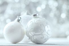 Silver and White Christmas balls. On shiny bokeh background with copy space stock photos