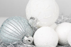 Silver and white christmas ornament decorated balls close up. Silver and white balls, christmas ornament decorated balls on white background stock photo