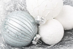 Silver and white christmas ornament decorated balls close up. Silver and white balls, christmas ornament decorated balls on white background royalty free stock image