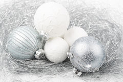 Silver and white christmas ornament decorated balls close up. Silver and white balls, christmas ornament decorated balls on white background royalty free stock photography