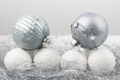 Silver and white christmas ornament decorated balls close up. Silver and white balls, christmas ornament decorated balls on white background royalty free stock photos
