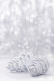 Silver and white Christmas ornaments on glitter bokeh background with space for text. Xmas and Happy New Year. Theme royalty free stock photo