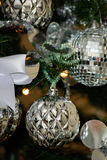 Silver and white Christmas tree decorations Stock Photos