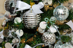 Silver and white Christmas tree decorations Stock Photo