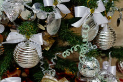 Silver and white Christmas tree decorations Royalty Free Stock Images