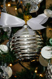 Silver and white Christmas tree decorations Royalty Free Stock Image