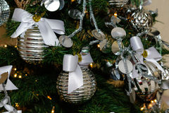 Silver and white Christmas tree decorations Stock Photography