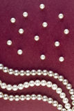 Silver and White pearls necklace on dark red Stock Image