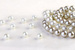 Silver and White pearls necklace on white paper Stock Photos
