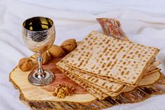 Silver wine cup with matzah, Jewish symbols for the Passover Pesach holiday. Passover concept. Jewish Matzah on Decorated Silver wine cup with matzah, Jewish Stock Image