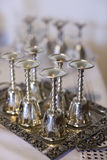 Silver wine glasses on tray (soft focus) Royalty Free Stock Images