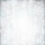 Silver winter, Christmas background with snowflake star pattern. Abstract silver background with faintly visible vertical stripes, stars and snow Stock Images