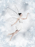 Silver winter fairy. Gorgeous young brunette woman as winter fairy with wings on shiny silver background royalty free stock photography