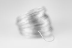 Silver Wire Macro on White. Macro of silver wire on white background with focus on the frayed end of the wire Stock Photos