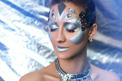 Silver woman future techno. Young beautiful bright showy girl lady model dancer queen. Fairy tale future party disco techno club. Art makeup flawless face silver Stock Photography
