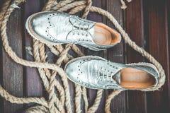 Silver women's shoes, vintage advertising photos Stock Photo