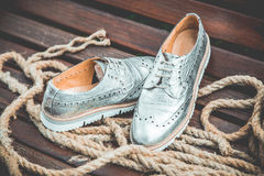 Silver women's shoes, vintage advertising photos Royalty Free Stock Images