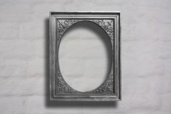 Silver wooden frames for pictures on old brick wall stock photography