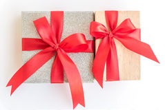 Silver and wooden gift box with red ribbon bow Stock Photo