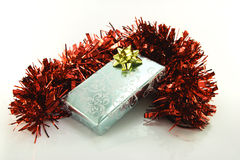 Silver Wrapped Gift with Tinsel Stock Photography