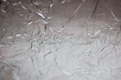 Silver wrinkled sheet metal is light, abstract images. Stock Photo