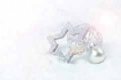 Silver xmas decoration. On snow Stock Image