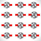 Silver year warranty button seal graphic with red ribbons Stock Photography