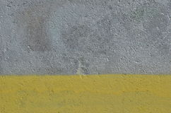 Silver and yellow paint background. Rough concrete wall painted in two rtectangular areas of yellow and silver color Royalty Free Stock Photography