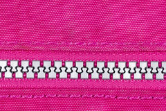 Silver Zip with Pink Cloth Stock Image